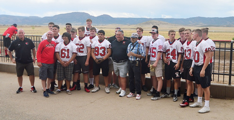 Bradshaw Mountain High School football players gather before taking on the jockeys from Arizona Downs in a tug-a-war Saturday, August 3, 2019, in on the racetrack in Prescott Valley.  (Les Stukenberg/Courier)