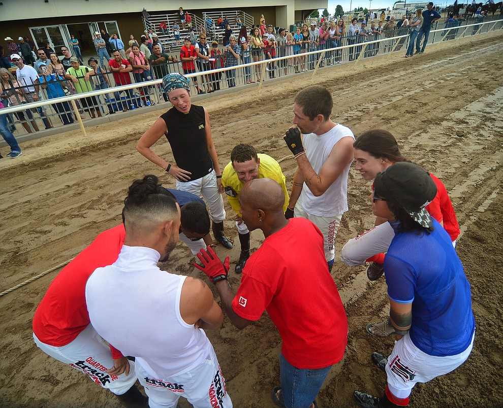 Jockeys from Arizona Downs get a pep talk before taking on Bradshaw Mountain High School football players in a tug-a-war Saturday, August 3, 2019, in on the racetrack in Prescott Valley.  (Les Stukenberg/Courier)