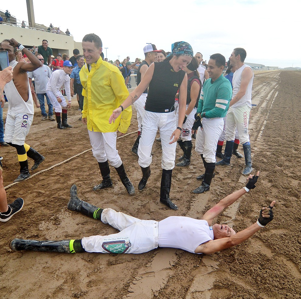 Richard Lull celebrates after the jockeys from Arizona Downs beat the Bradshaw Mountain High School football players in a tug-a-war Saturday, August 3, 2019, in on the racetrack in Prescott Valley.  (Les Stukenberg/Courier)