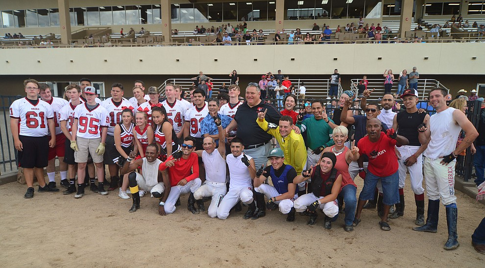 Bradshaw Mountain High School football players and jockeys from Arizona Downs gather after a competitive tug-a-war Saturday, August 3, 2019, in on the racetrack in Prescott Valley.  (Les Stukenberg/Courier)