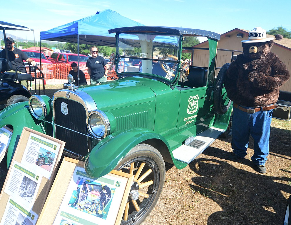 Smokey Bear poses with the 1925 Dodge Brothers USFS truck at the 45th Annual Prescott Antique Auto Club Watson Lake Car Show Saturday, August 3, 2019, in Prescott. The show continues Sunday from 8 a.m. to 3 p.m. (Les Stukenberg/Courier)