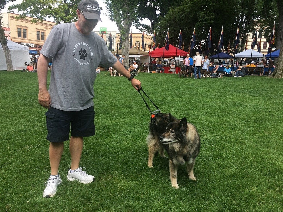 Trooper, who won 'Most Beautiful Senior' and Robin Green at the Woof Down Lunch at courthouse plaza Saturday, Aug. 3. (Jason Wheeler/Courier)