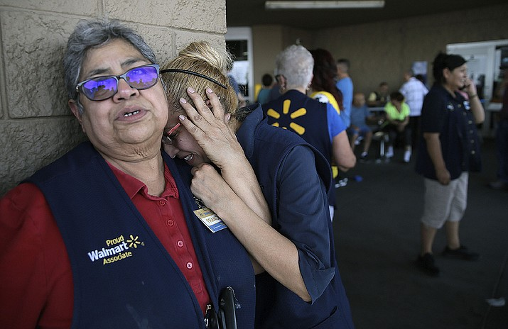 Walmart employees react after a man opened fire at the store in El Paso, Texas, Saturday, Aug. 3, 2019. (Mark Lambie/The El Paso Times via AP)