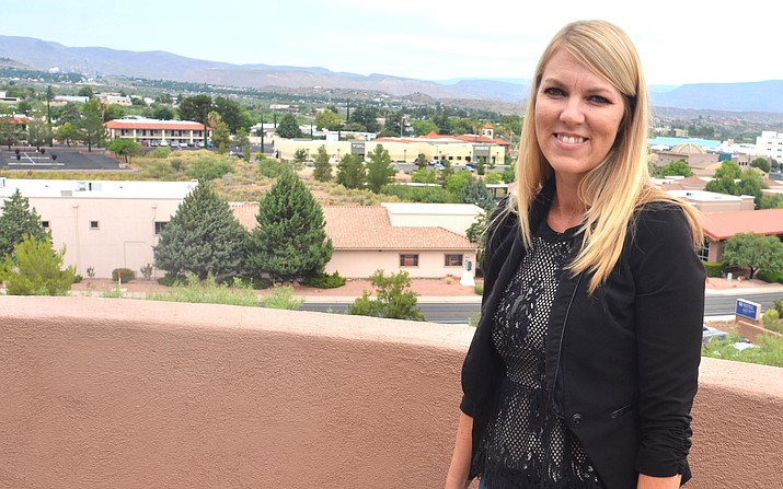 April Rhodes, CEO of Spectrum, outside an office at Spectrum's main campus in Cottonwood. VVN/Vyto Starinskas