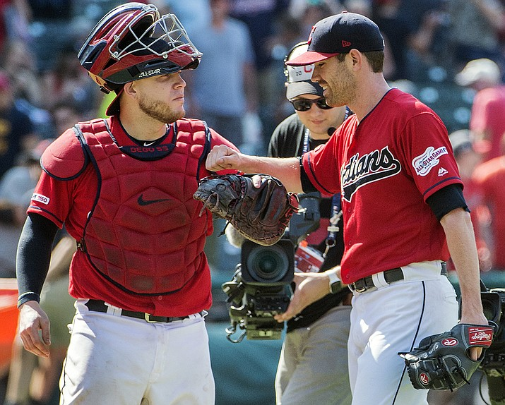 Cleveland Indians' Roberto Perez, left, and starter Shane Bieber celebrate their win over the Los Angeles Angels in a baseball game in Cleveland, Sunday, Aug. 4, 2019. (Phil Long/AP)