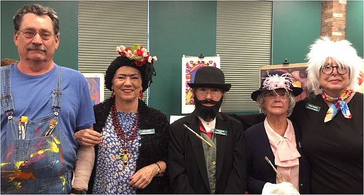 Prescott Art Docents members enjoy the 2018 Membership Reception at the Prescott Public Library. From left are Louis Reeves appearing as Diego Rivera, Ann Ramsey as Frieda Kahlo, Janice Woods as Toulouse Lautrec, Nancy Slain as Mary Cassatt, and Penny Watson as Andy Warhol. (Prescott Art Docents/Courtesy)