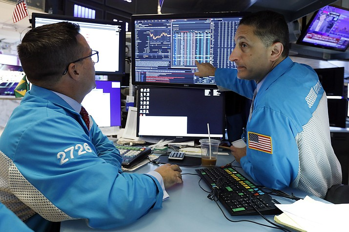 Specialists Paul Cosentino, left, and Jeffrey Berger work on the floor of the New York Stock Exchange, Monday, Aug. 5, 2019. U.S. stocks nosedived in early trading on Wall Street Monday as China's currency fell sharply and stoked fears that the trade war between the world's two largest economies would continue escalating. (AP Photo/Richard Drew)