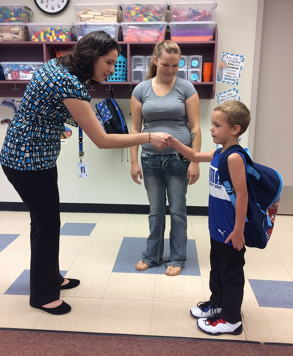 Territorial Early Childhood Center First Grade Teacher Danielle Frederic meets Bentlee Baldwin for the first day of school Monday, Aug. 5, while mother Kylie Baldwin watches their meeting. (Jason Wheeler/Courier)