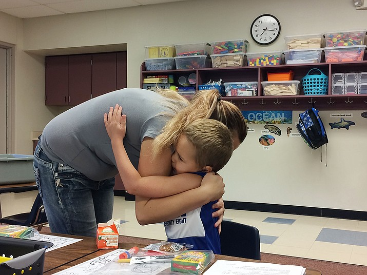 Bentlee Baldwin hugs mother Kylie Baldwin before the beginning of the first day of school at Territorial Early Childhood Center on Monday, Aug. 5. (Jason Wheeler/Courier)