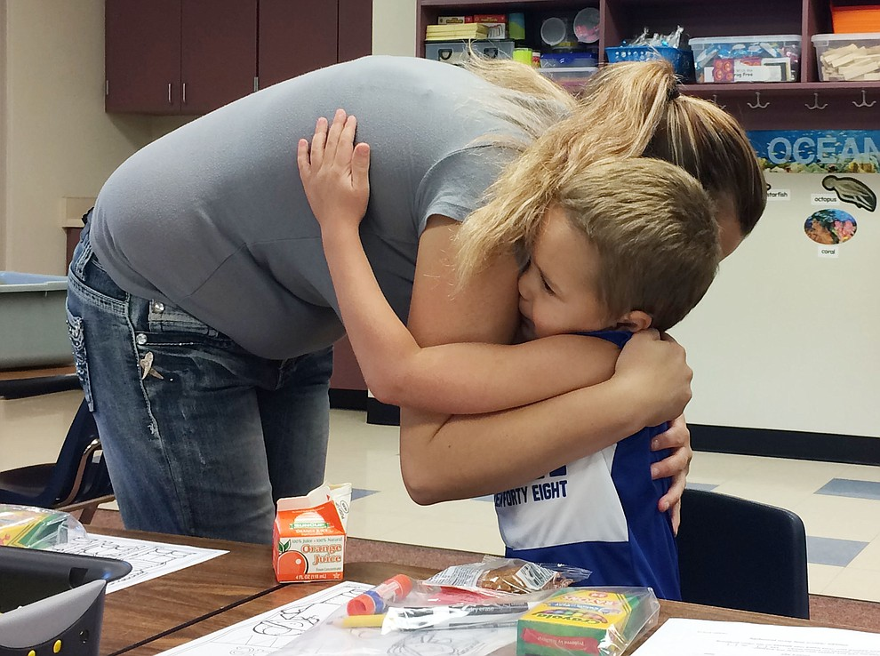 Bentlee Baldwin hugs mother Kylie Baldwin before the beginning of the first day of school at Territorial Early Childhood Center Monday, Aug. 5. (Jason Wheeler/Courier)