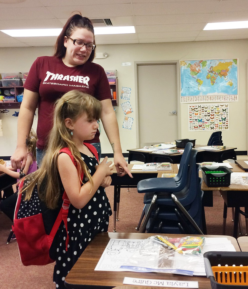 Layla McGuire finds her desk with mother Theresa McGuire in tow before the start of the first day of school at Territorial Early Childhood Center Monday, Aug. 5. (Jason Wheeler/Courier)