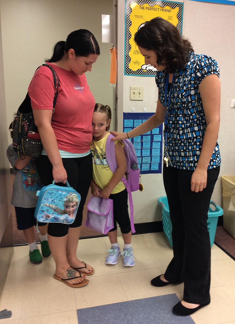 Lacey Whitcomb, with mother Michelle Whitcomb, meets Territorial Early Childhood Center First Grade Teacher Danielle Frederic before the start of the first day of school at Territorial Early Childhood Center Monday, Aug. 5. (Jason Wheeler/Courier)