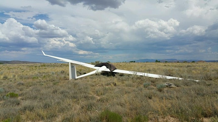 Central Arizona Fire and Medical (CAFMA) personnel responded to a glider that landed in a field off Big Chino Road, near Bull Snake Road in Paulden Sunday afternoon, Aug. 4. The pilot reportedly received non-life-threatening injuries after hitting a power box located in the field. (CAFMA/Courtesy)
