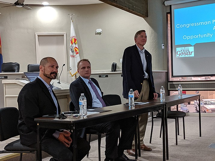 Congressman Paul Gosar, far right, talked opportunity zones in Kingman alongside Chief of Staff Thomas Van Flein (left) and attorney Brett Siglin (center). (Photo by Travis Rains/Daily Miner)