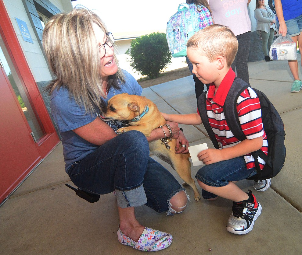 Principal Candice Stump greets Parker Woods as students in the Humboldt Unified School District returned to school at Coyote Springs Elementary School Monday, August 5, 2019, in Prescott Valley.  (Les Stukenberg/Courier)
