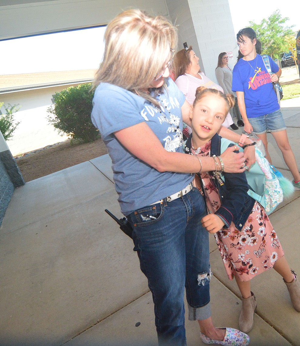 Principal Candice Stump greets Gemma Yost as students in the Humboldt Unified School District returned to school at Coyote Springs Elementary School Monday, August 5, 2019, in Prescott Valley.  (Les Stukenberg/Courier)