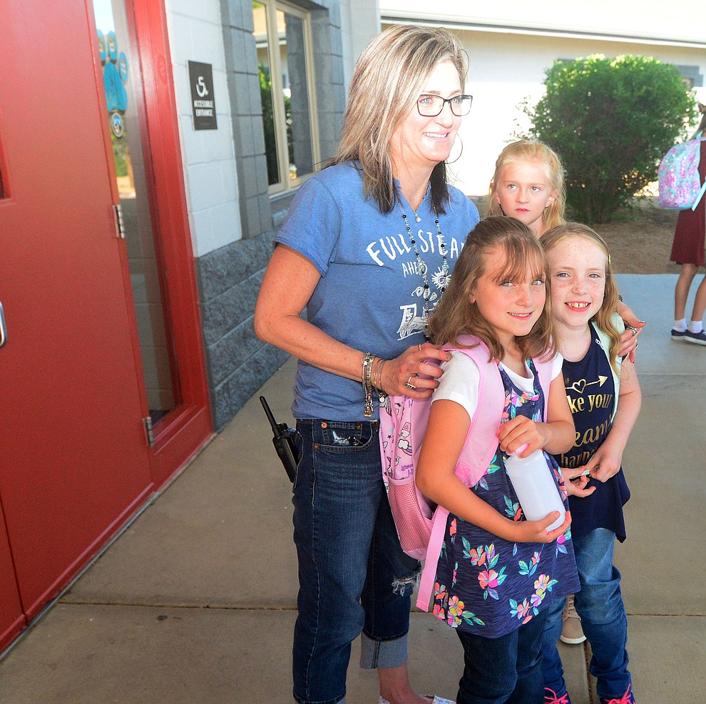 Principal Candice Stump poses for a photo with Lexie and Vi Martinez as students in the Humboldt Unified School District returned to school at Coyote Springs Elementary School Monday, August 5, 2019, in Prescott Valley.  (Les Stukenberg/Courier)