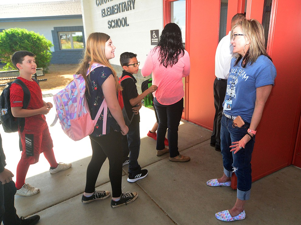 Principal Candice Stump greets students as the Humboldt Unified School District returned to school at Coyote Springs Elementary School Monday, August 5, 2019, in Prescott Valley.  (Les Stukenberg/Courier)