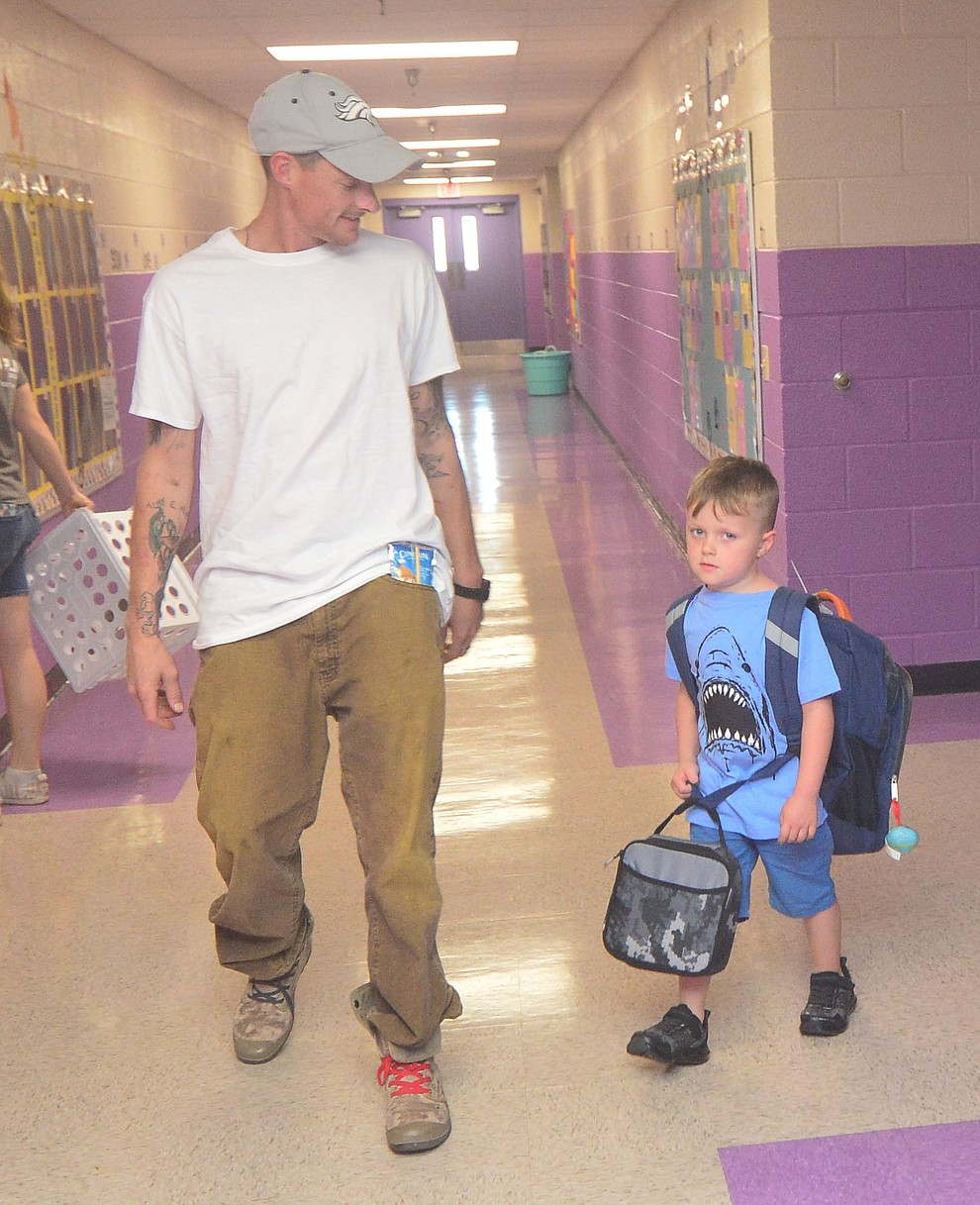 Lawrence Easthouse and his son Ronyn wait for kindergarten to start as students in the Humboldt Unified School District returned to school at Coyote Springs Elementary School Monday, August 5, 2019, in Prescott Valley.  (Les Stukenberg/Courier)