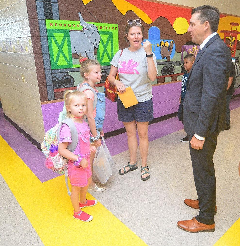 Superintendent Dan Streeter greets the Barknowitz family, Kasey, Emma and Beth as students in the Humboldt Unified School District returned to school at Coyote Springs Elementary School Monday, August 5, 2019, in Prescott Valley.  (Les Stukenberg/Courier)