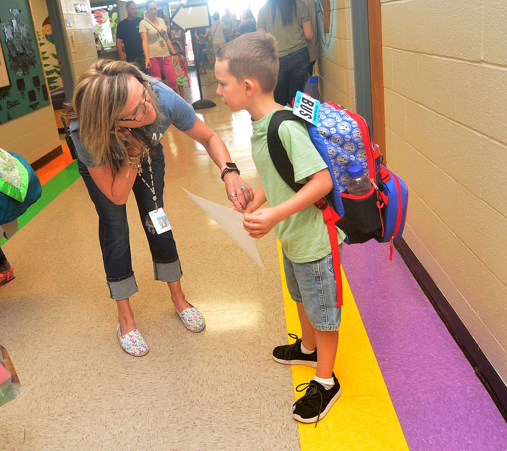 Principal Candice Stump helps Cole Johnson find his class as students in the Humboldt Unified School District returned to school at Coyote Springs Elementary School Monday, August 5, 2019, in Prescott Valley.  (Les Stukenberg/Courier)