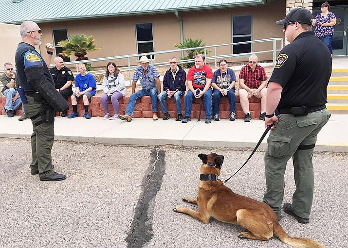 Yavapai-Apache Police Officer Joshua Collins, and K-9 officer Loki, do a demonstration for ranchers from Rainbow Acres during a tour of the Camp Verde Marshal's Office. VVN/Bill Helm