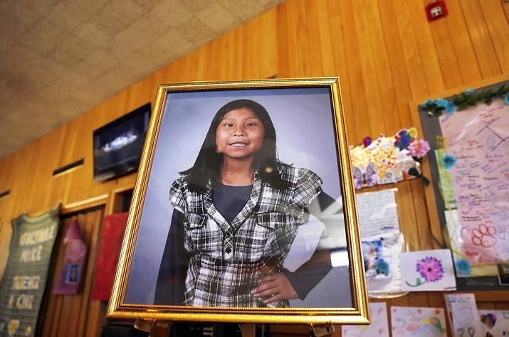 This May 6, 2016 photo shows a portrait of 11-year-old Ashlynne Mike on display inside the lobby of the Farmington Civic Center in Farmington, N.M. The mother of Ashlynne, a Navajo girl who was abducted and killed in 2016, is urging tribal officials to take advantage of tools and funding that have been made available for responding to reports of missing Native American children. Pamela Foster's comments July 30, came during a training in Albuquerque for tribes to implement the alert system. Organizers say more than 20 tribes are participating in the training. (Jon Austria/The Daily Times via AP, File)