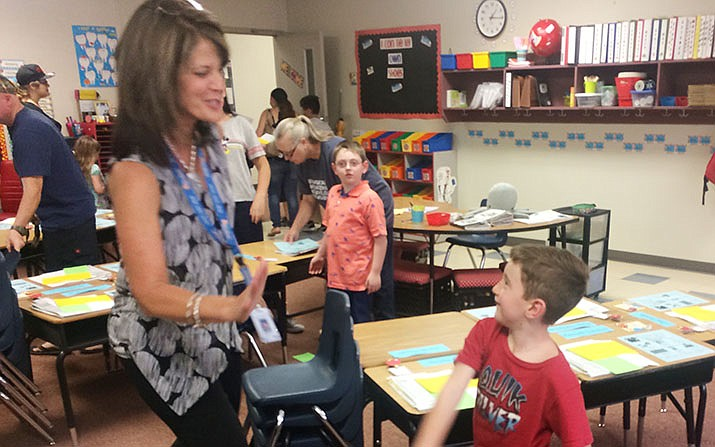 Wyatt Macilroy gives Territorial Early Childhood Center Principal Brandy Cox a high-five during the Meet the Teacher event Thursday, Aug. 1. (Jason Wheeler/Review)