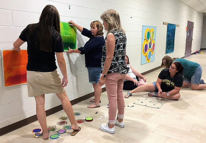 Lake Valley Elementary School teachers and staff met July 25 to set up equipment in the new sensory hallway inside the entrance to the school. An $18,315 donation from Jewish Community Foundation helped pay for tiling the floor and the equipment. (Sue Tone/Tribune)