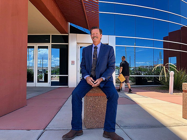 Supervisor Ron Gould of District 5 poses in front of Mohave County Administrative Building, 700 W. Beale St. on Monday Aug. 5, 2019. (Photo by Agata Popeda/Daily Miner)