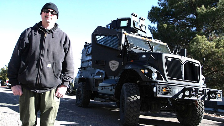 Cottonwood Police Officer Chris Dowell shown earlier this year with the department's tactical vehicle, known as a Mine-Resistant Ambush Protected – or MRAP for short. VVN/Bill Helm