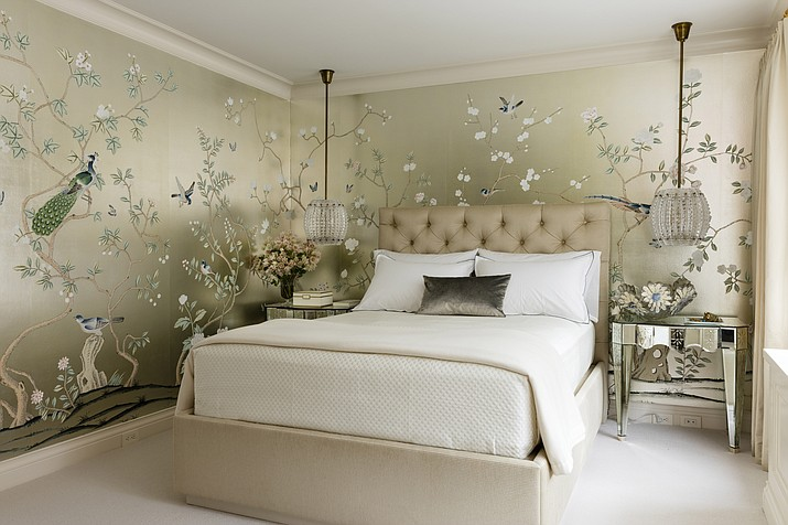 "This master bedroom, which interior designer Joan Craig designed, has a hand-painted Chinoiserie gilded silk from de Gournay. ""Wallpaper is having its day,"" says Craig. ""We can't get enough of it and neither can our clients."" Antoine Bootz/Craig & Company via AP)"