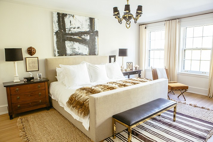 This undated photo shows a master bedroom designed by Lauren Buxbaum Gordon. The natural fiber rug adds warmth and softness around the bed, while a smaller throw rug adds a touch of bold pattern. (Heather Talbert/Nate Berkus Associates/Lauren Buxbaum Gordon via AP)