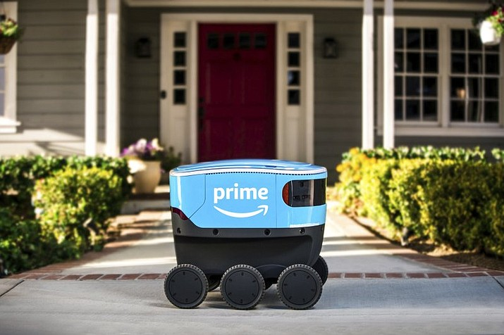 FILE - This undated photo provided by Amazon shows a self-driving delivery robot that Amazon is calling Scout. Amazon is expanding the use of its self-driving delivery robots to a second state.  The online shopping giant says the six-wheeled robots, about the size of a Labrador, will start delivering packages to customers in Irvine, Calif. Amazon.com Inc. has been testing them in a Seattle suburb since the beginning of the year. (Amazon via AP, File)