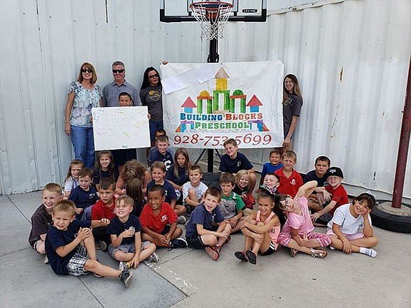Nucor Steel Kingman, LLC and Lifetime Products, Clearfield, Utah, recently donated a basketball hoop to Building Blocks Preschool in Kingman. Pictured in the back, left to right, are Coreena Frashefski, Rod Sales Manager and Matt Blitch, Plant Manager, at Nucor Steel Kingman, along with some of the staff and students at Building Blocks. (Photo courtesy of Nucor Steel Kingman, LLC)