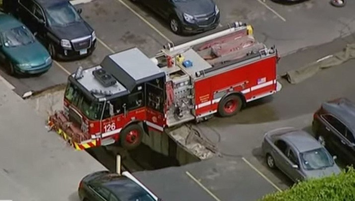 A firetruck became stuck on the second level of a Chicago parking garage after the asphalt underneath the vehicle partially collapsed. (Associated Press)