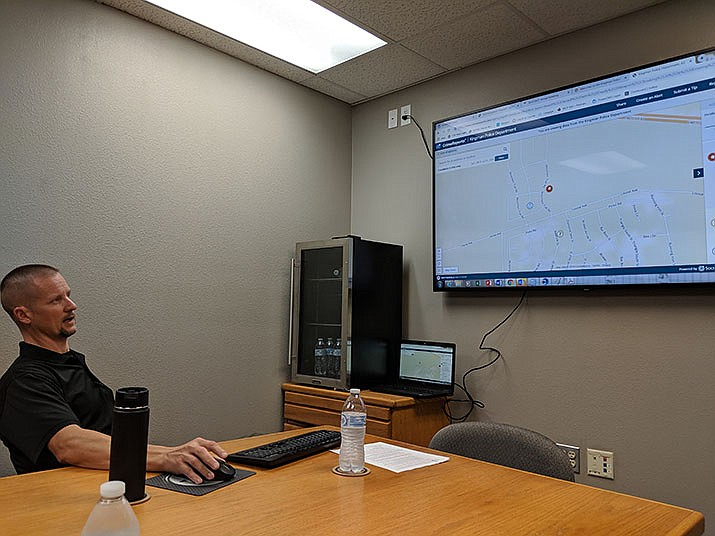 Deputy Chief Evan Kunert demonstrates how to use the interactive crime map available at the Kingman Police Department website. (Photo by Travis Rains/Daily Miner)
