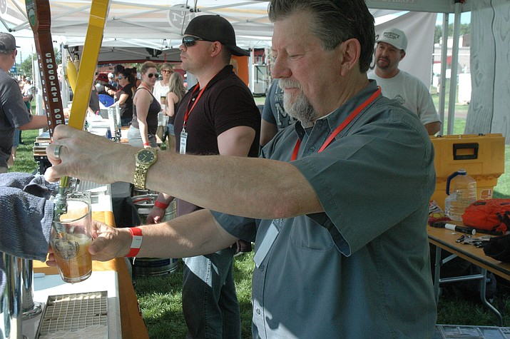 Mark Oglesby of Prescott Brewing Company pours a glass of Liquid Amber at the annual Mile High Brewfest. Prescott Brewing Company is one of more than 25 brewers expected at this year's Brewfest, which is Saturday, Aug. 10. (Jason Wheeler/Courier, file)