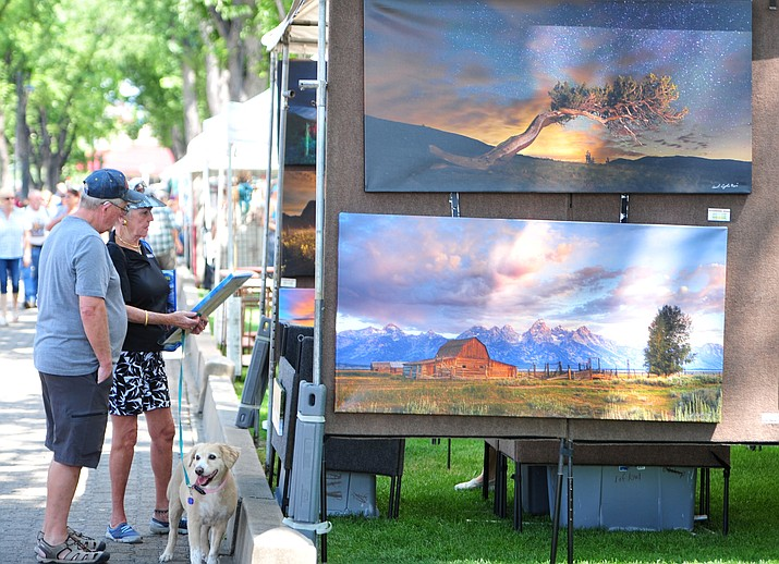 Large crowds visit the booths at the Mountain Artists Guild's 68th annual August Arts & Crafts Festival Saturday, Aug. 11, 2018 on the courthouse plaza in Prescott. This year's festival is Aug. 10-11. (Les Stukenberg/Courier, file)