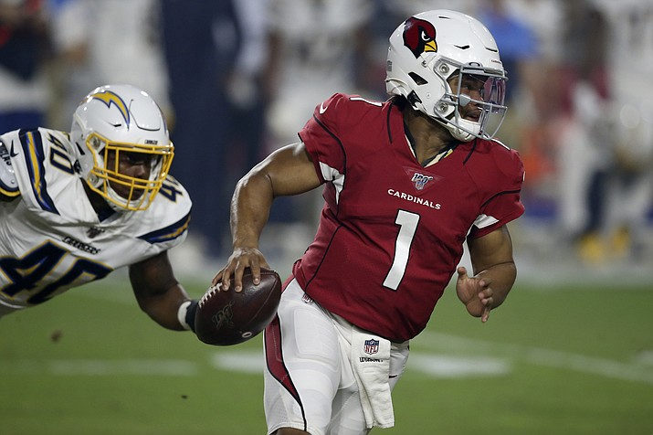 Arizona Cardinals quarterback Kyler Murray (1) tries to elude Los Angeles Chargers linebacker Chris Peace (40) during the first half of a preseason game, Thursday, Aug. 8, 2019, in Glendale, Ariz. (Ross D. Franklin/AP)