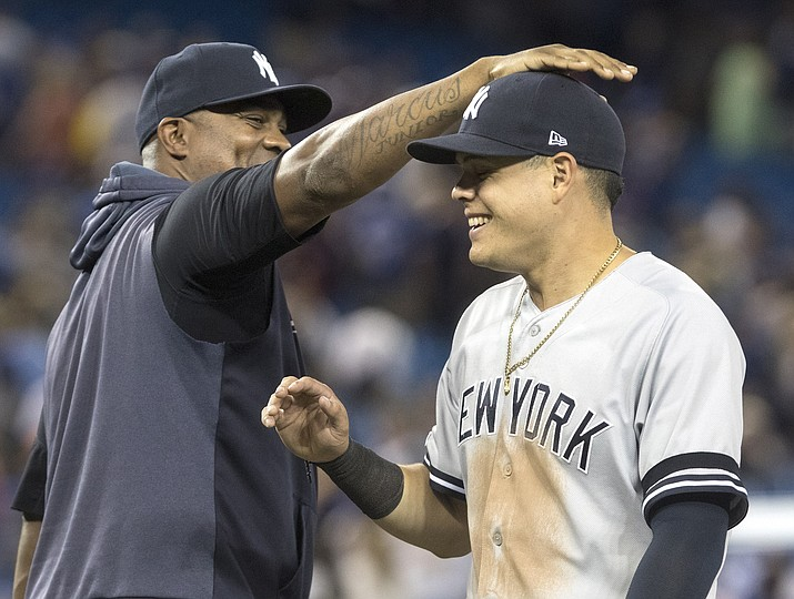 New York Yankees' Gio Urshela celebrates with C.C. Sabathia after the Yankees defeated the Toronto Blue Jays 12-6 in a game Thursday, Aug. 8, 2019, in Toronto. (Fred Thornhill/The Canadian Press via AP)