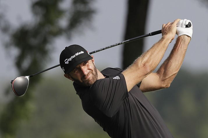 Dustin Johnson tees off on the 13th hole in the Northern Trust tournament at Liberty National Golf Course, Thursday, Aug. 8, 2019, in Jersey City, N.J. (Mark Lennihan/AP)