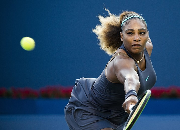 Serena Williams, of the United States, returns the ball to Ekaterina Alexandrova, of Russia, during the Rogers Cup women's tennis tournament Thursday, Aug. 8, 2019, in Toronto. (Nathan Denette/The Canadian Press via AP)