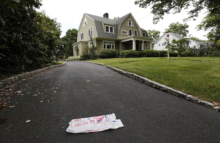 In this June 25, 2015, file photo, a newspaper rests on the driveway of the home of Derek and Maria Broaddus in Westfield, N.J. Derek and Maria Broaddus bought the Westfield home for $1,355,657 in 2014, but they didn't move in after receiving the first of four letters from the anonymous stalker. NJ.com reports Andrew and Allison Carr purchased it for $959,360. It was originally listed for $1.25 million in 2016. (AP Photo/Julio Cortez, File)
