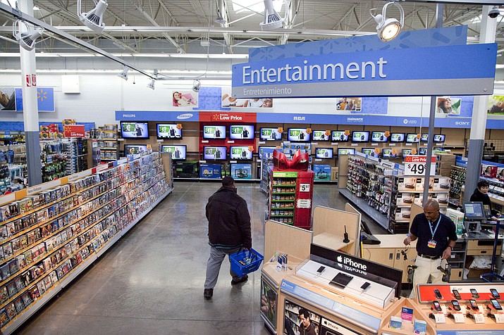 In this Dec. 15, 2010 file photo, a view of the entertainment section of a Wal-Mart store is seen in Alexandria, Va. Walmart is taking down all signs and displays from its stores that depict violence, following a mass shooting at its El Paso, Texas location that left 22 people dead. The retailer, according to an internal memo, instructed employees to turn off or unplug any video game consoles that show violent games, as well as ensure that no movies depicting violence are playing in its electronics departments. (AP Photo, File)