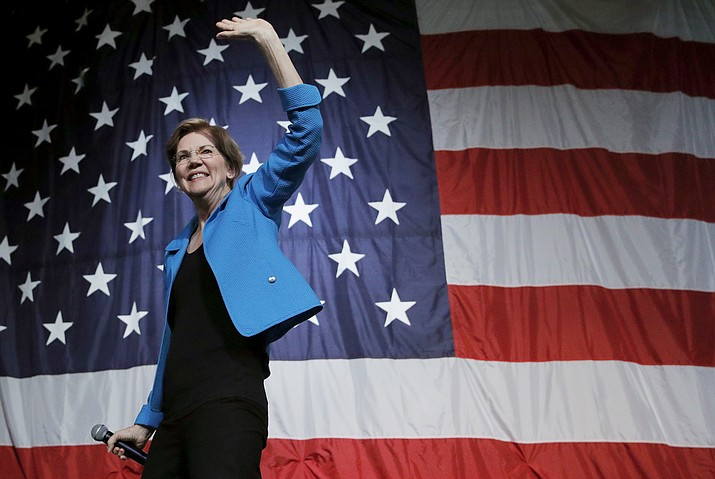 Democratic presidential candidate Sen. Elizabeth Warren, D-Mass., waves after speaking at the Iowa Democratic Wing Ding at the Surf Ballroom, Friday, Aug. 9, 2019, in Clear Lake, Iowa. (John Locher/AP)