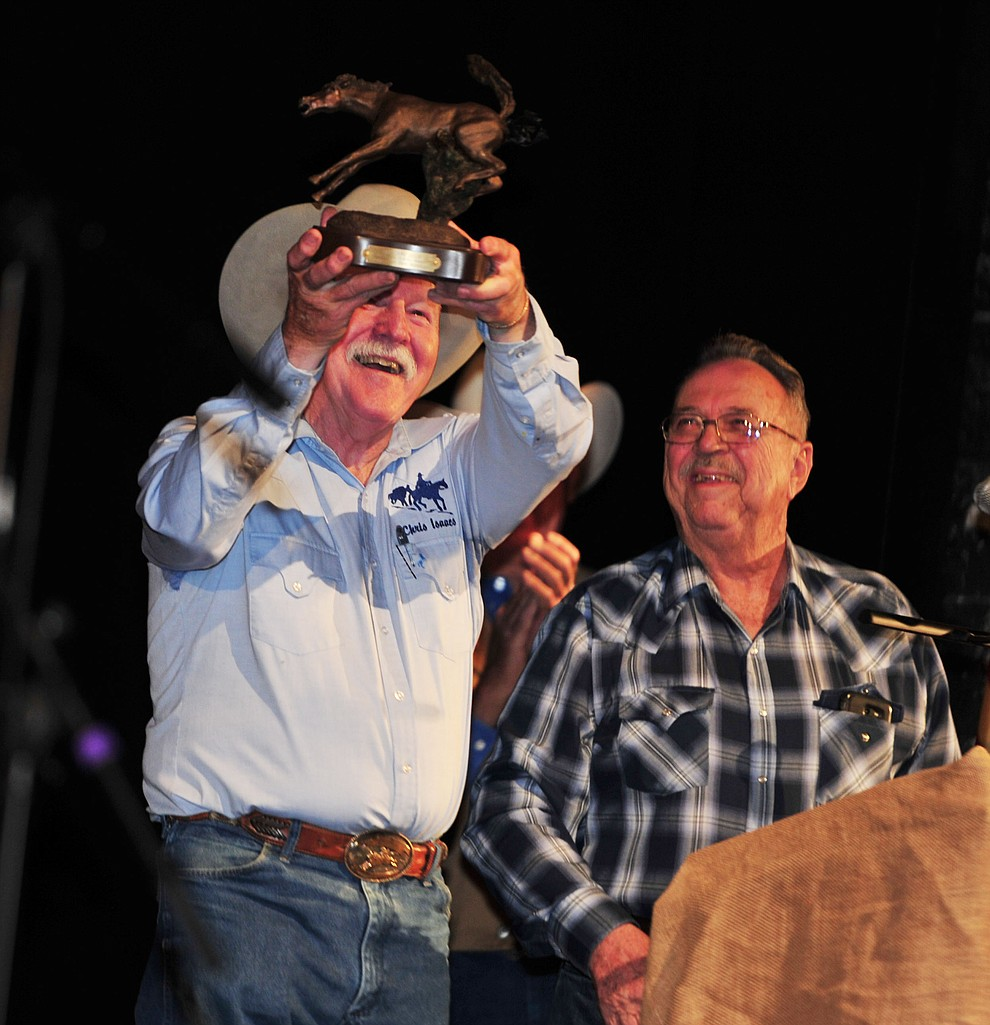 Chris Isaacs receives The Flying Horse statue made by his friend Dave Ridenhour in the opening ceremonies at the 32nd Annual Arizona Cowboy Poets Gathering Friday, August 9, 2019, being held at the Prescott campus of Yavapai College. The event continues Saturday with workshops from 9 a.m. to 5 p.m. and a show, tickets required, at the Performance Hall at 7 p.m. featuring Mark Munzert, Gail Steiger, Jay Snider and The Cowboy Way Trio. (Les Stukenberg/Courier)