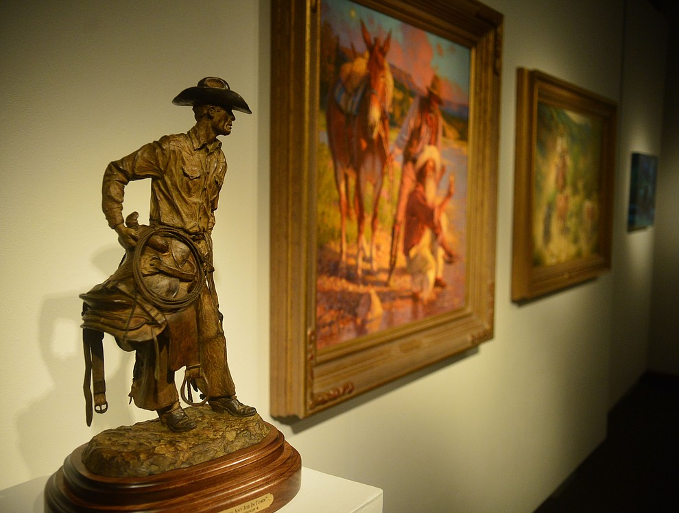 Artists Joe Netherwood, Bill Nebeker, Steve Atkinson, Shawn Cameron and Marless Fellows have artwork on display in the Yavapai College Gallery at the 32nd Annual Arizona Cowboy Poets Gathering Friday, August 9, 2019, being held at the Prescott campus of Yavapai College. The event continues Saturday with workshops from 9 a.m. to 5 p.m. and a show, tickets required, at the Performance Hall at 7 p.m. featuring Mark Munzert, Gail Steiger, Jay Snider and The Cowboy Way Trio. (Les Stukenberg/Courier)