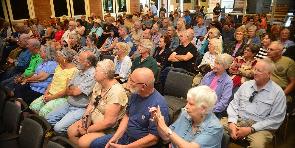 A large crowd watches the Rusty Pistols Reloaded perform in the first breakout session at the 32nd Annual Arizona Cowboy Poets Gathering Friday, August 9, 2019, being held at the Prescott campus of Yavapai College. The event continues Saturday with workshops from 9 a.m. to 5 p.m. and a show, tickets required, at the Performance Hall at 7 p.m. featuring Mark Munzert, Gail Steiger, Jay Snider and The Cowboy Way Trio. (Les Stukenberg/Courier)