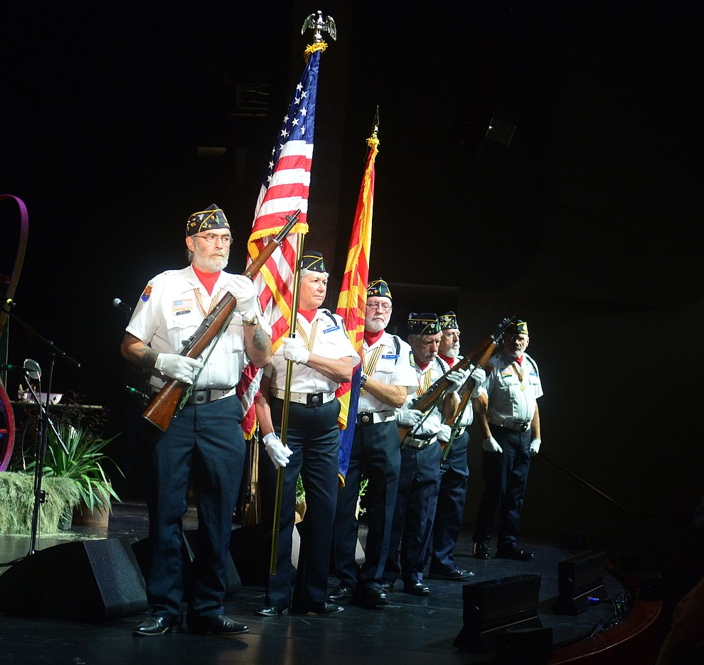 American Legion Post 6 Color Guard posts the colors at the 32nd Annual Arizona Cowboy Poets Gathering Friday, August 9, 2019, being held at the Prescott campus of Yavapai College. The event continues Saturday with workshops from 9 a.m. to 5 p.m. and a show, tickets required, at the Performance Hall at 7 p.m. featuring Mark Munzert, Gail Steiger, Jay Snider and The Cowboy Way Trio. (Les Stukenberg/Courier)